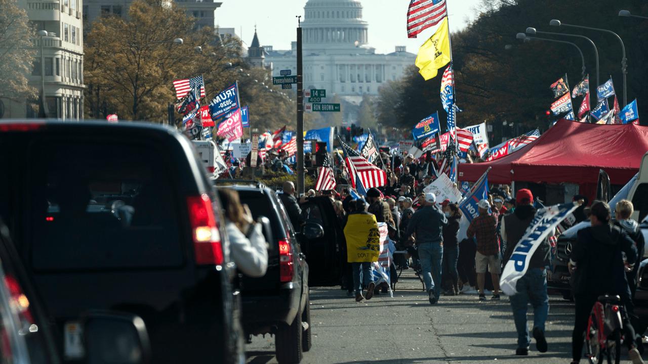 MAGA protesters cheer Trump motorcade drive-by