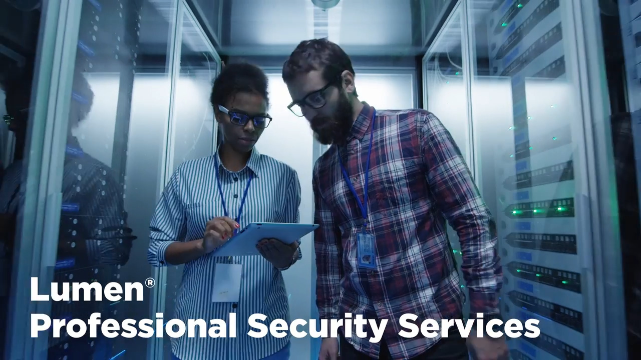 Two business people looking at a tablet in the middle of two server stacks with a white text overlay for Lumen professional security services