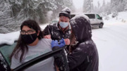 Stranded Health Workers Give COVID-19 Vaccines to Drivers on Snowy Highway