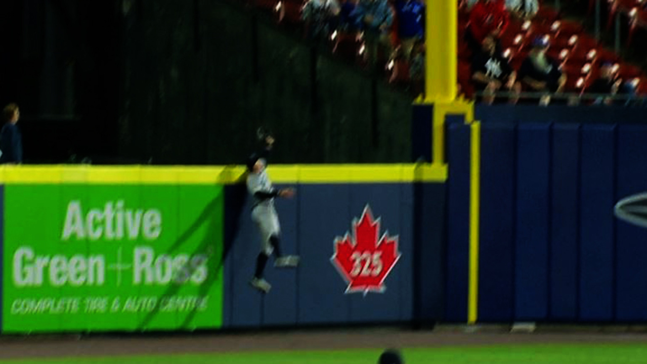Aaron Judge jumps and stretches over the wall to steal a two-run homer from Cavan Biggio