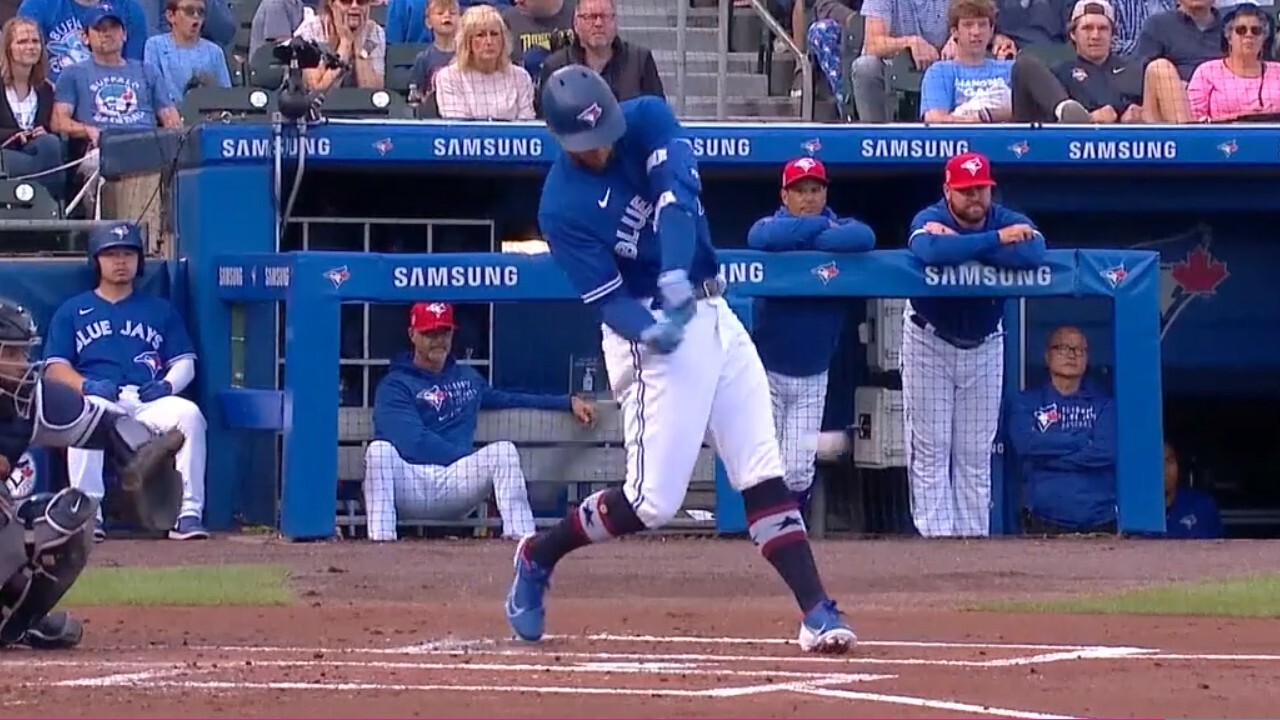 Blue Jays Springer throws a two-run shot to deep center in the first inning.