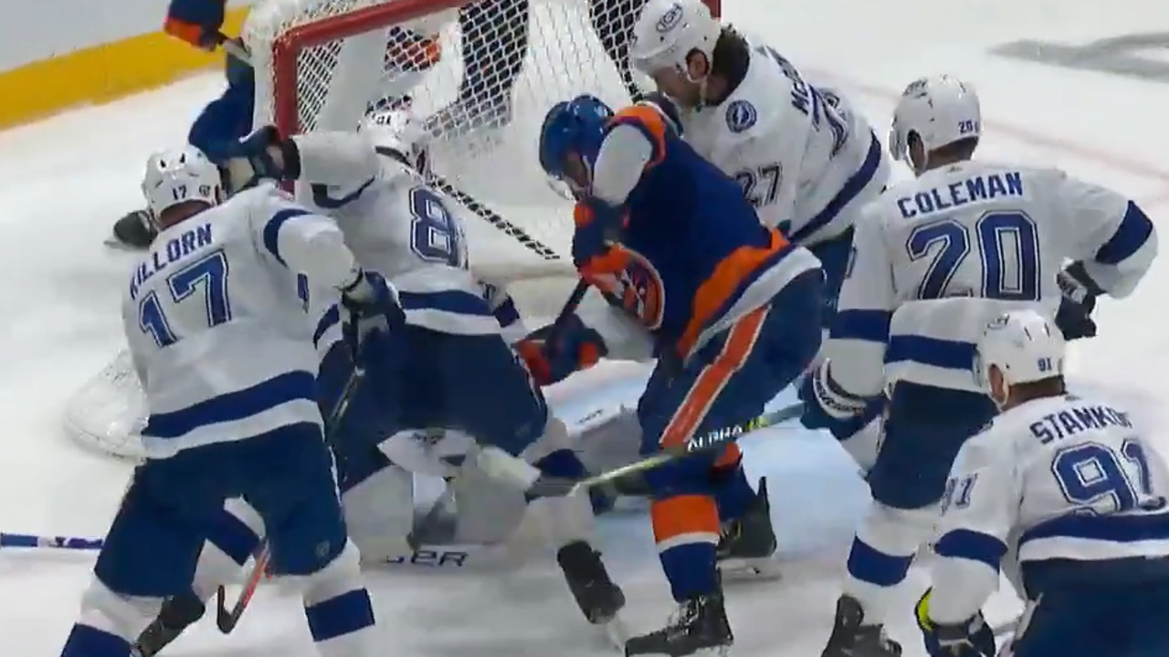 Clutterbuck scores after puck passes Vasilevskiy and enters the net
