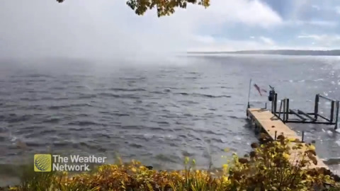 WATCH A WALL OF FOG DANCE ITS WAY ACROSS THE LAKE