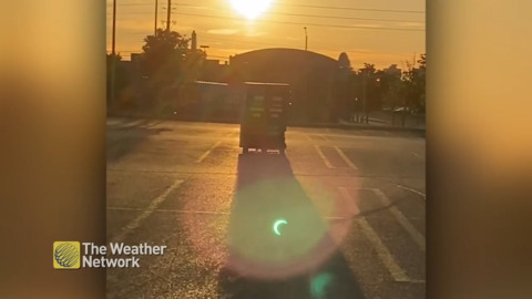 SOLAR ECLIPSE IS SEEN IN THE LENS FLARE PICKED UP ON CAMERA