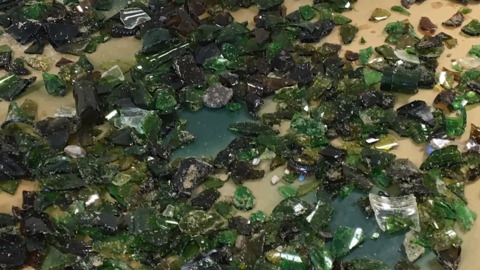 SOMEONE LEFT THOUSANDS OF SHARDS OF GLASS ON A LAKE MICHIGAN BEACH