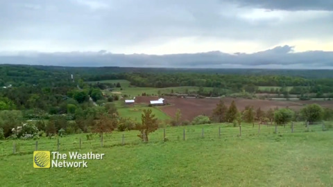 TIME-LAPSE OF STORM CLOUDS MOVING OVER FARM
