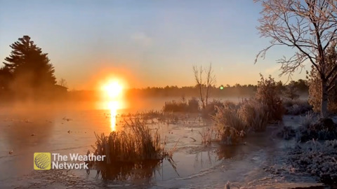 SUNRISE SHINES LIKE FIRE ON CRYSTAL-COLD SCENE IN BEAUTIFUL CANADIANA TIME LAPSE