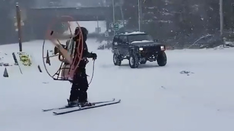 SKIER STRAPS A GIANT FAN TO HIS BACK WHICH ACTUALLY WORKS QUITE WELL