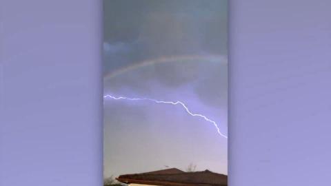 'MAGIC': AUSTRALIANS AWED BY LIGHTNING FLASHING ACROSS A DOUBLE RAINBOW