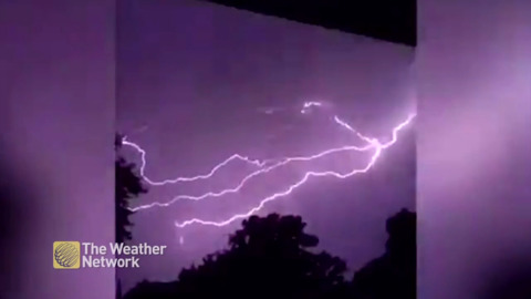 LIGHTNING BOLTS FORK ACROSS THE SKY AND STRIKE IN BRILLIANT FLASHES