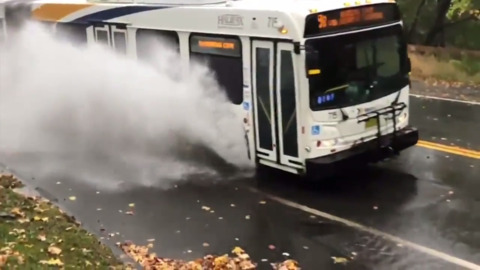 CITY BUS CRASHES THROUGH MASSIVE PUDDLE IN MUST-SEE SLOW-MOTION VIDEO