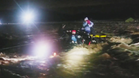TENSE MOMENTS AS A FAMILY OF FIVE AND THEIR DOG WERE RESCUED FROM RAGING FLOODWATERS