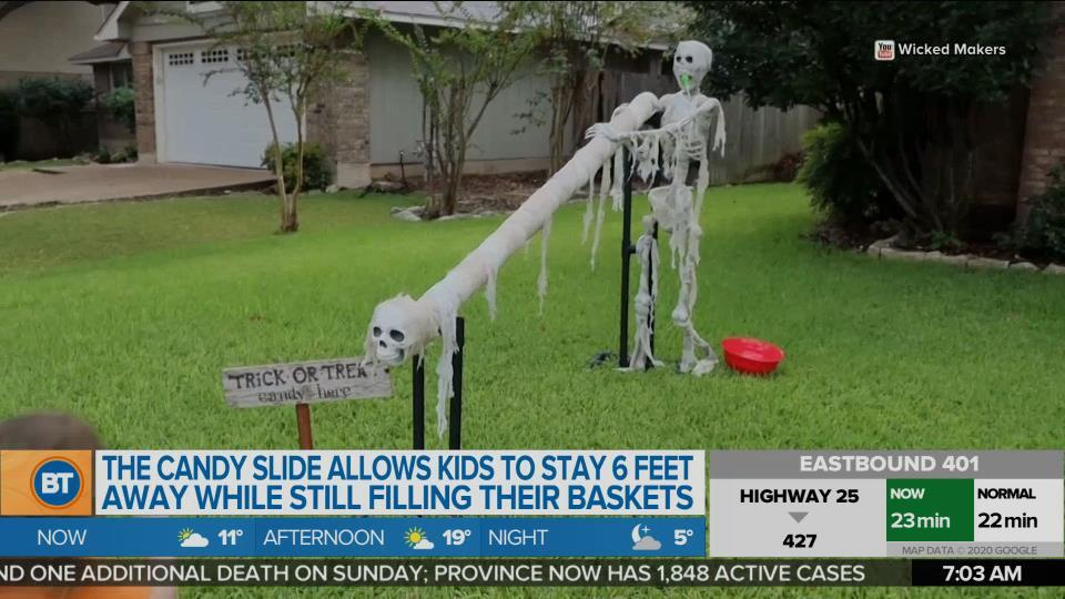 A couple creates a candy slide for safe Trick-Or-Treating