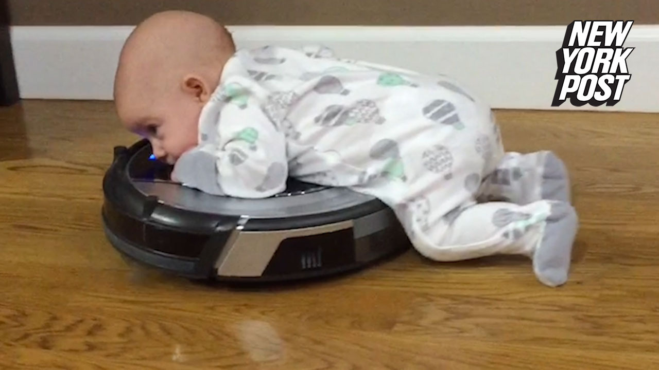 Roomba makes baby's 'tummy time' 100% cuter