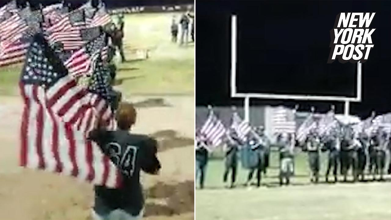 Video High School Football Team Proudly Stand Up For The Flag