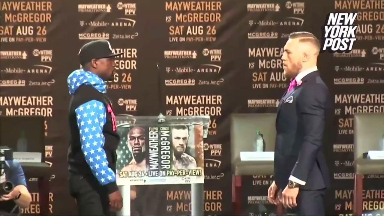 newest 3bbfd 656a1 McGregor uses NBA jersey to taunt Mayweather's despicable past