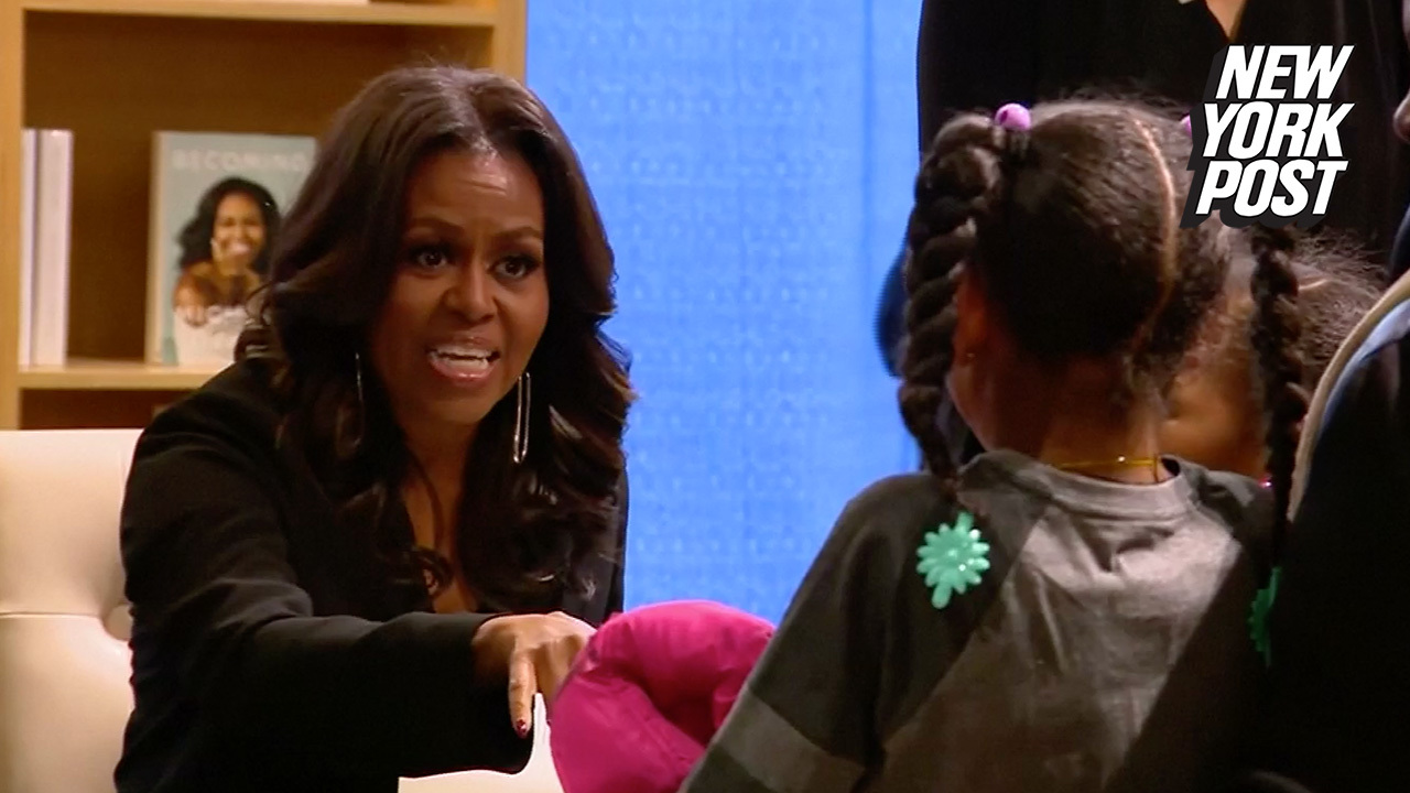 Michelle Obama greets readers at book signing