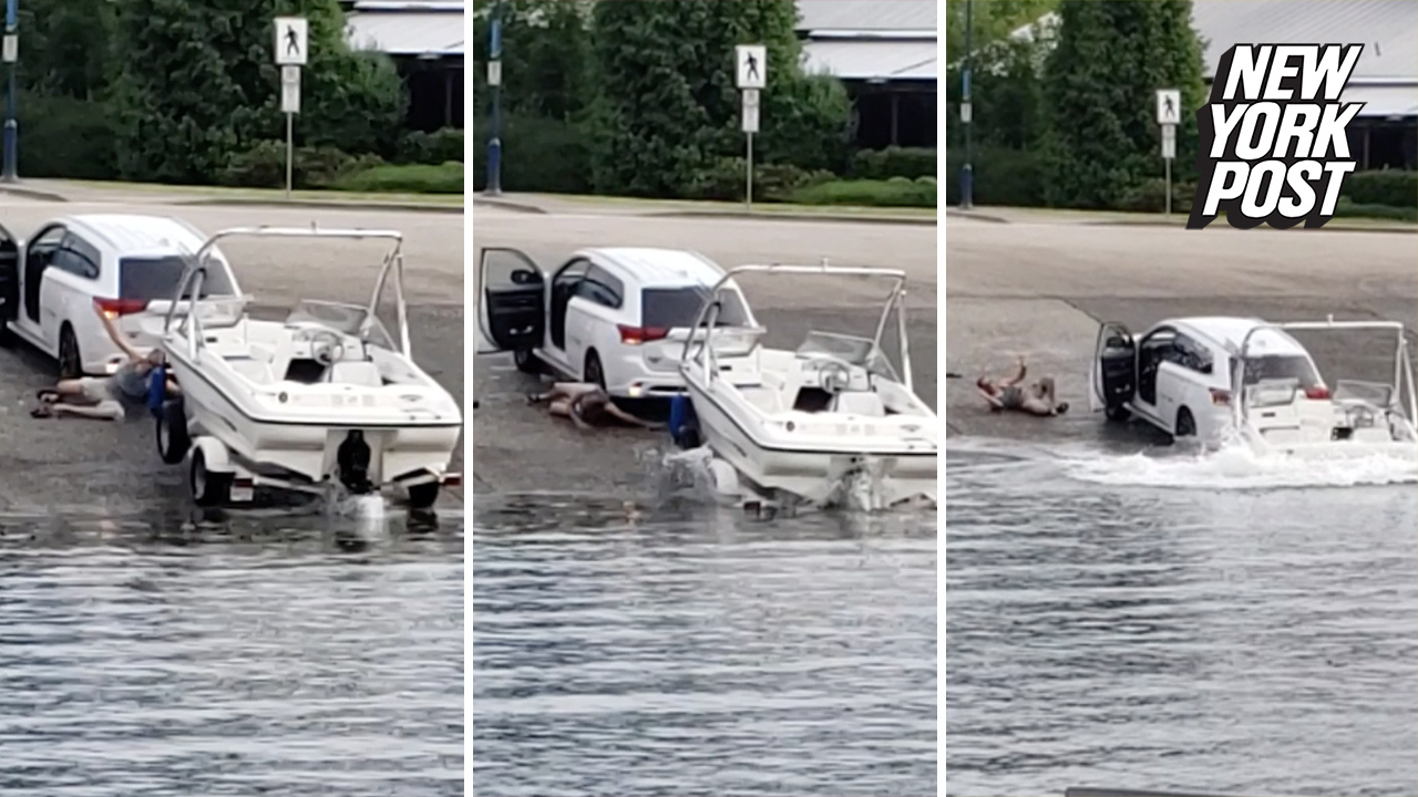 Man dodges death as boat drags SUV into the water