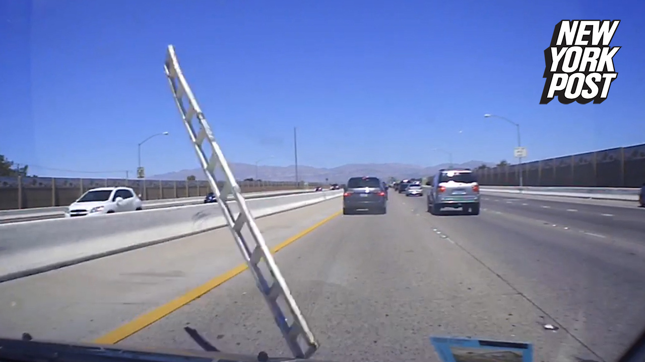 Flying ladder crashes into driver's windshield
