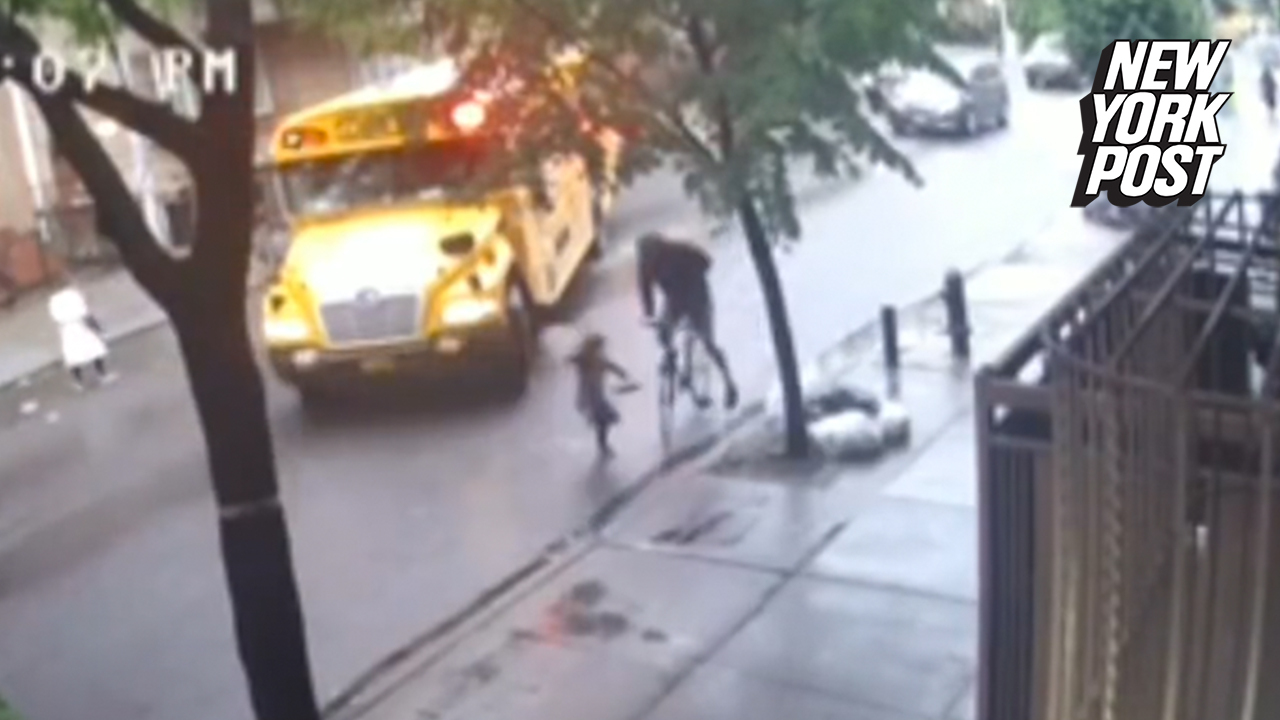 Video shows girl getting off bus get hit by bicyclist