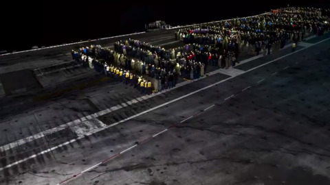 USS George H.W. Bush aircraft carrier crew hold flashlight vigil