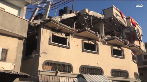 Collapsed roof, damaged vehicles at site of deadly Israeli strike on Gaza militant