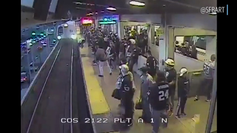 BART worker drags fallen passenger to safety inches from train
