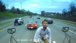 Man stops school bus in traffic, jumps on hood to ask unusual question