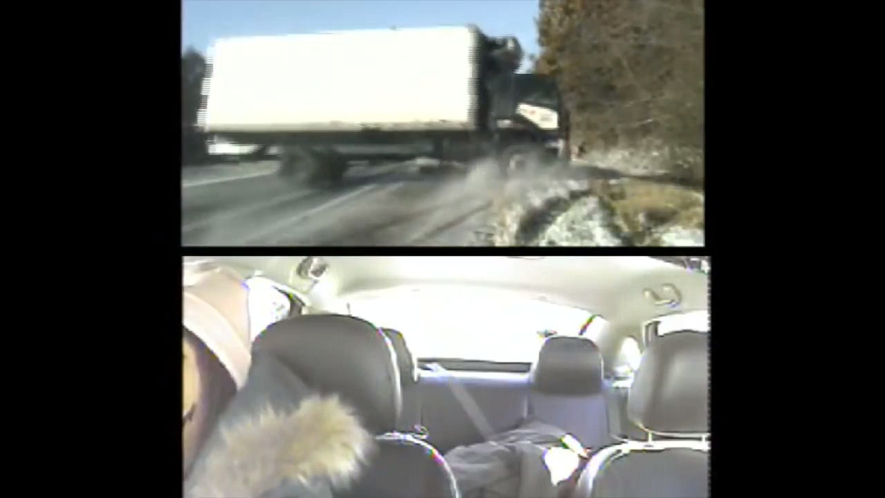 'Watch out!' Cops drag woman from path of box truck sliding on icy Illinois highway