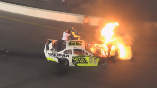 Father pulls son from burning car after race crash