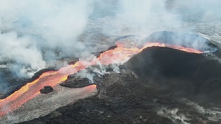 See lava erupt from a fissure at Hawaii's Kilauea volcano