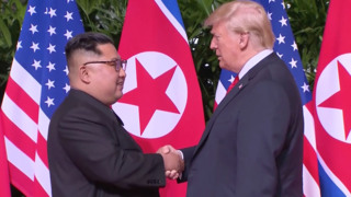 Trump and Kim shake hands for a historic first