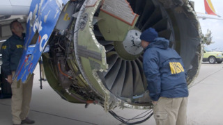 Aviation safety crew inspects grounded Southwest plane after fatal incident