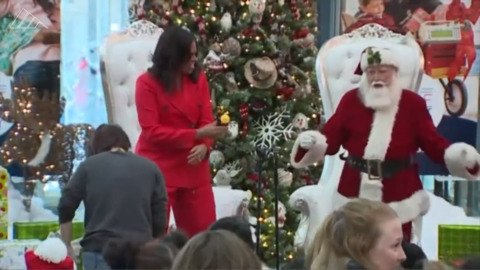 Michelle Obama and Santa Claus do popular dance