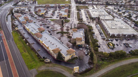 Drone view shows proposed Elk Grove hospital site and businesses that must move