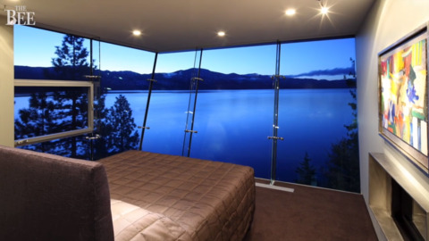 See Lake Tahoe home with amazing views via glass walls, glass staircase, glass elevator