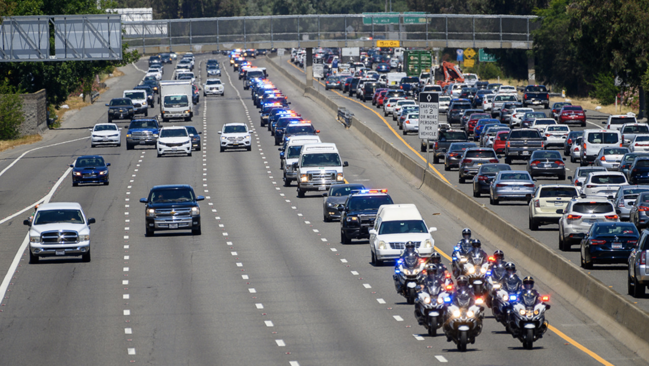 Officers salute Tara O'Sullivan during funeral procession from Sacramento to Elk Grove