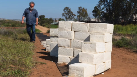 Artist builds 6-foot-high cheese wall on the US-Mexico border in California
