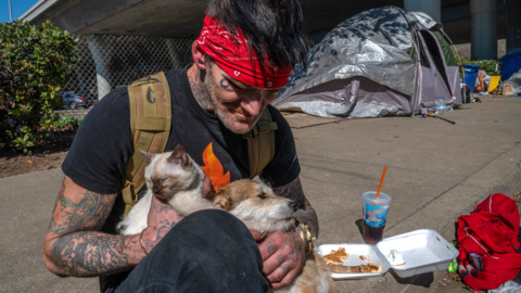 Who will be displaced in a homeless encampment under the W-X freeway?