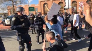 Crowd chants 'Say his name' while approaching officers in protest