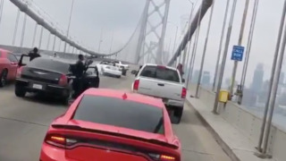 Vehicles stop traffic on the Bay Bridge to engage in dangerous 'Fast and Furious'-style sideshow
