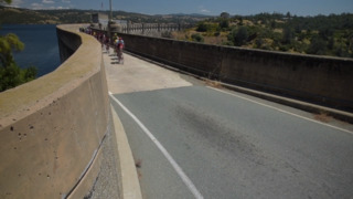 Amgen cyclists race cross scenic Pardee Dam on route to Elk Grove