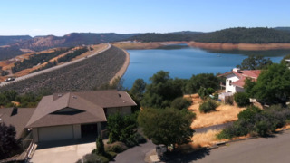 Fly over the Oroville Dam spillway and Lake Oroville area