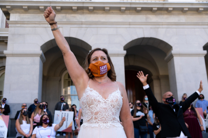 'The event industry has been forgotten.' See protesters march in wedding gowns and tuxes