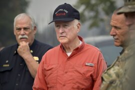 Gov. Jerry Brown tours the destruction of the Carr Fire near Redding