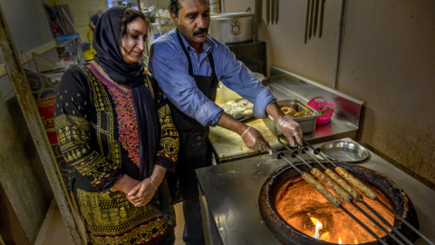 See how the clay oven oven cooks kebabs and naan at the same time at Kabab Corner
