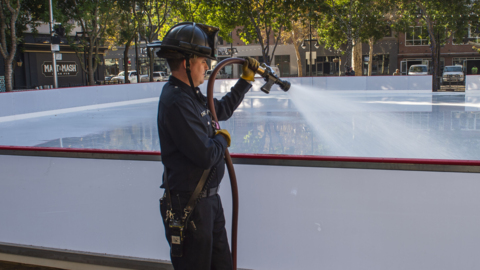 Drone view shows firefighters help freeze bigger ice rink in downtown Sacramento