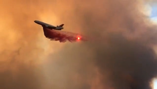 Close up look at Cal Fire plane dropping fire retardant on River Fire
