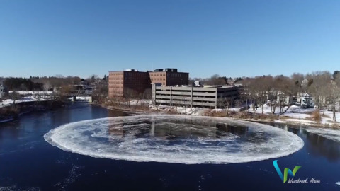 Take a look at this revolving ice disk on a river that has a city talking