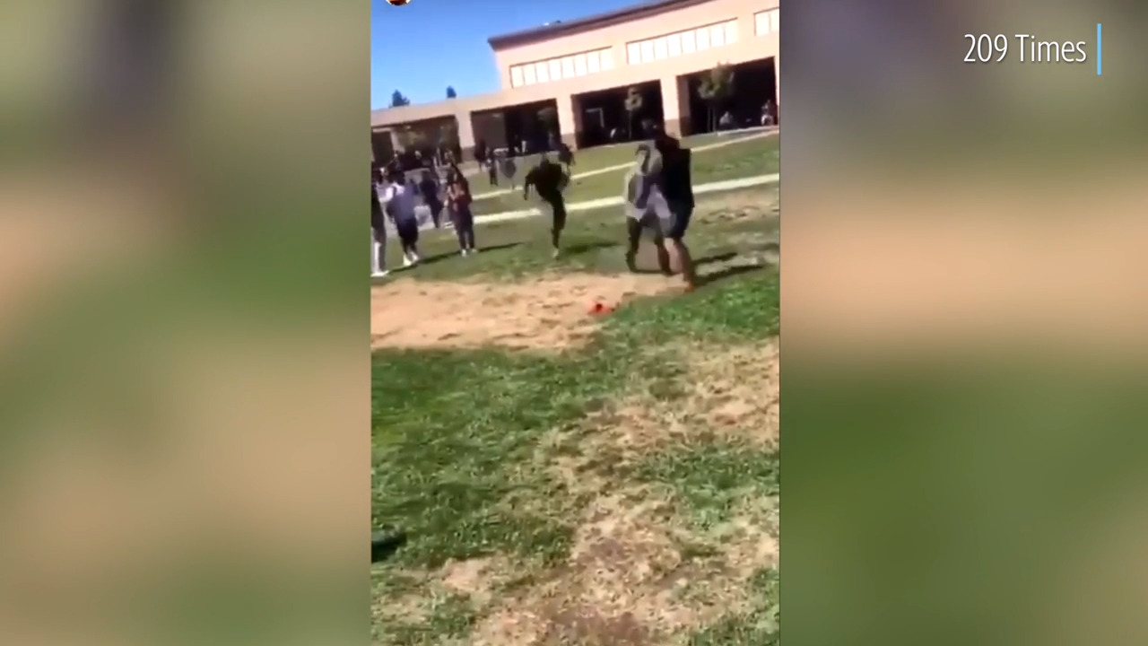 Watch Marine's flying tackle knocking two fighting Stockton students to the ground